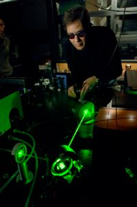 Image of Marcos Dantus with lasers