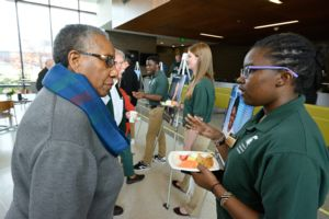 Image of CWQ participant talking with a Dean's Research Scholar during the networking break